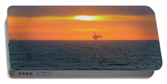 Silhouetted Oil Drilling Platform  Portable Battery Charger by Allan Levin
