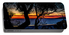 Silhouettes Over Blue Water Portable Battery Charger