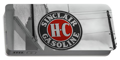Portable Battery Charger featuring the photograph Sinclair Gasoline Round Sign In Selective Color by Doug Camara