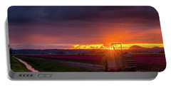 Portable Battery Charger featuring the photograph Skagit Valley Tractor Sunstar by Mike Reid