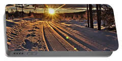 Ski Trails With Sun Beams Portable Battery Charger