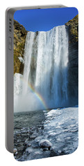 Portable Battery Charger featuring the photograph Skogafoss Waterfall Iceland In Winter by Matthias Hauser