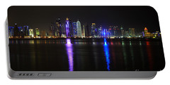 Skyline Of Doha, Qatar At Night Portable Battery Charger