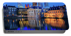 Skyline Of The Hague At Dusk During Blue Hour Portable Battery Charger