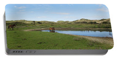 Small Lake With Wild Horses Portable Battery Charger