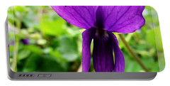 Portable Battery Charger featuring the photograph Small Violet Flower by Jean Bernard Roussilhe