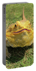 Portable Battery Charger featuring the photograph  Smiling Bearded Dragon  by Susan Leggett