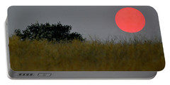Portable Battery Charger featuring the photograph Smokey Sunset by AJ Schibig