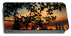 Portable Battery Charger featuring the photograph Smoked Filled Sunset by Janice Westerberg