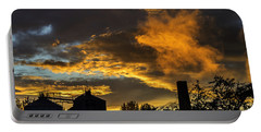 Portable Battery Charger featuring the photograph Smoky Sunset by Jeremy Lavender Photography