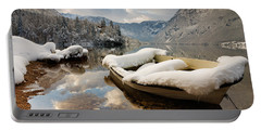 Snow Covered Boat On Lake Bohinj In Winter Portable Battery Charger