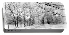 Snow Covered River Road Portable Battery Charger by Kathy M Krause