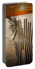 Snow Fence At Sunset Portable Battery Charger