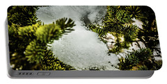 Portable Battery Charger featuring the photograph Snow In The Trees by Bill Howard