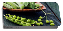 Snow Peas Or Green Peas Still Life Portable Battery Charger by Vishwanath Bhat