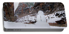 Snowman In Zion Portable Battery Charger by Daniel Woodrum