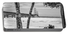 Portable Battery Charger featuring the photograph Snowmobile Michigan Black And White  by John McGraw