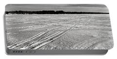 Snowmobile Tracks On China Lake Portable Battery Charger