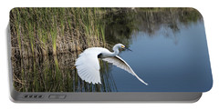 Snowy Egret Flying Over Blue Lake Portable Battery Charger