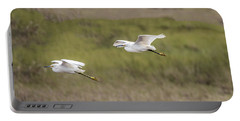 Snowy Egret Pair Flying Across A Plain Portable Battery Charger