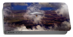 Portable Battery Charger featuring the photograph Soaring Through The Clouds by Susan Rissi Tregoning