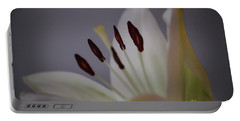 Soft Lily Portable Battery Charger by Roberta Byram