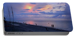 Southeast Side Of A Sunset Portable Battery Charger by Carol Bradley
