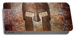 Spartan Helmet On Rusted Riveted Metal Sheet Portable Battery Charger
