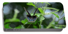Spicebush Swallowtail On Sweet Almond Flower Portable Battery Charger by Carol Bradley