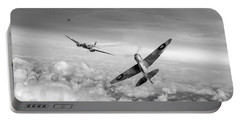 Portable Battery Charger featuring the photograph Spitfire Attacking Heinkel Bomber Black And White Version by Gary Eason