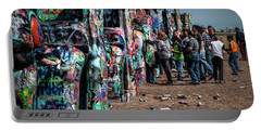 Portable Battery Charger featuring the photograph Spray Paint Fun At Cadillac Ranch by Randall Nyhof