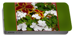 Portable Battery Charger featuring the pyrography Spring Annuals by Elly Potamianos