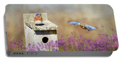 Portable Battery Charger featuring the photograph Spring Builders by Lori Deiter