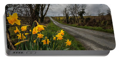Portable Battery Charger featuring the photograph Spring Daffodils On An Irish Country Road by James Truett