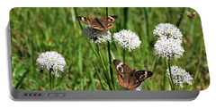Portable Battery Charger featuring the photograph Spring Delight Butterflies by Sheila Brown