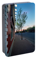 Portable Battery Charger featuring the photograph St. Anne Street At Dusk by Darcy Michaelchuk