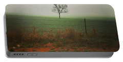 Standing Alone, A Lone Tree In The Fog. Portable Battery Charger