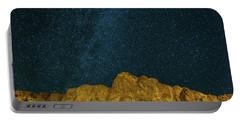 Starry Night Sky Over Rocky Landscape Portable Battery Charger