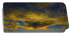 Portable Battery Charger featuring the photograph Steamy Sunset by Mark Blauhoefer