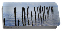 Portable Battery Charger featuring the photograph Sticks Out To Sea by Stephen Mitchell