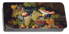 Still Life Of Melon Plums Grapes Cherries Strawberries On Stone Ledge Portable Battery Charger