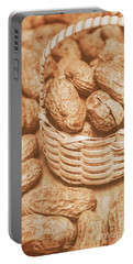 Still Life Peanuts In Small Wicker Basket On Table Portable Battery Charger