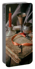 Portable Battery Charger featuring the photograph Still Life With Old Book And Metal Dishes by Jaroslaw Blaminsky
