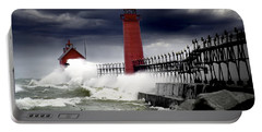 Storm At The Grand Haven Lighthouse Portable Battery Charger by Randall Nyhof