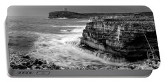 Portable Battery Charger featuring the photograph stormy sea - Slow waves in a rocky coast black and white photo by pedro cardona by Pedro Cardona