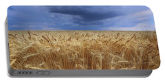 Portable Battery Charger featuring the photograph Stormy Wheat Field by Lynn Hopwood