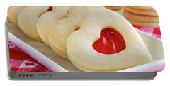 Portable Battery Charger featuring the photograph Strawberry Jam Filled Heart Cookies by Teri Virbickis