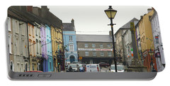Portable Battery Charger featuring the photograph Streets Of Cahir by Marie Leslie