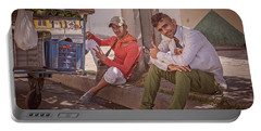 Portable Battery Charger featuring the photograph Street Vendors In Cienfuegos Cuba by Joan Carroll