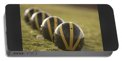 Striped Helmets On Yard Line Portable Battery Charger